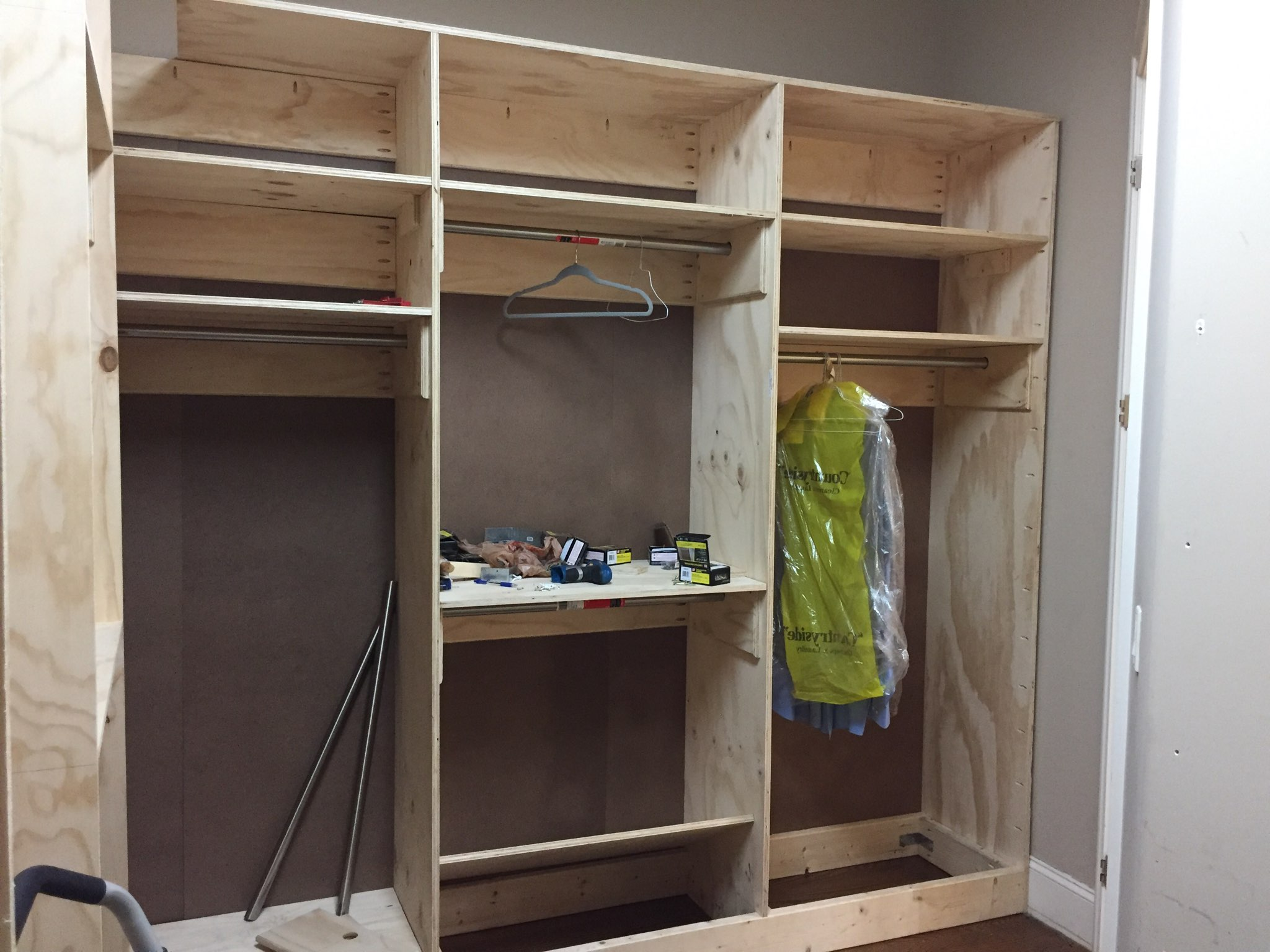 Picture of one of four sections of the walk-in closet. Size of this section is 9ft x 8ft (LxH), i.e., excluding a 2ft tall compartment (not shown) that fits at the top.
